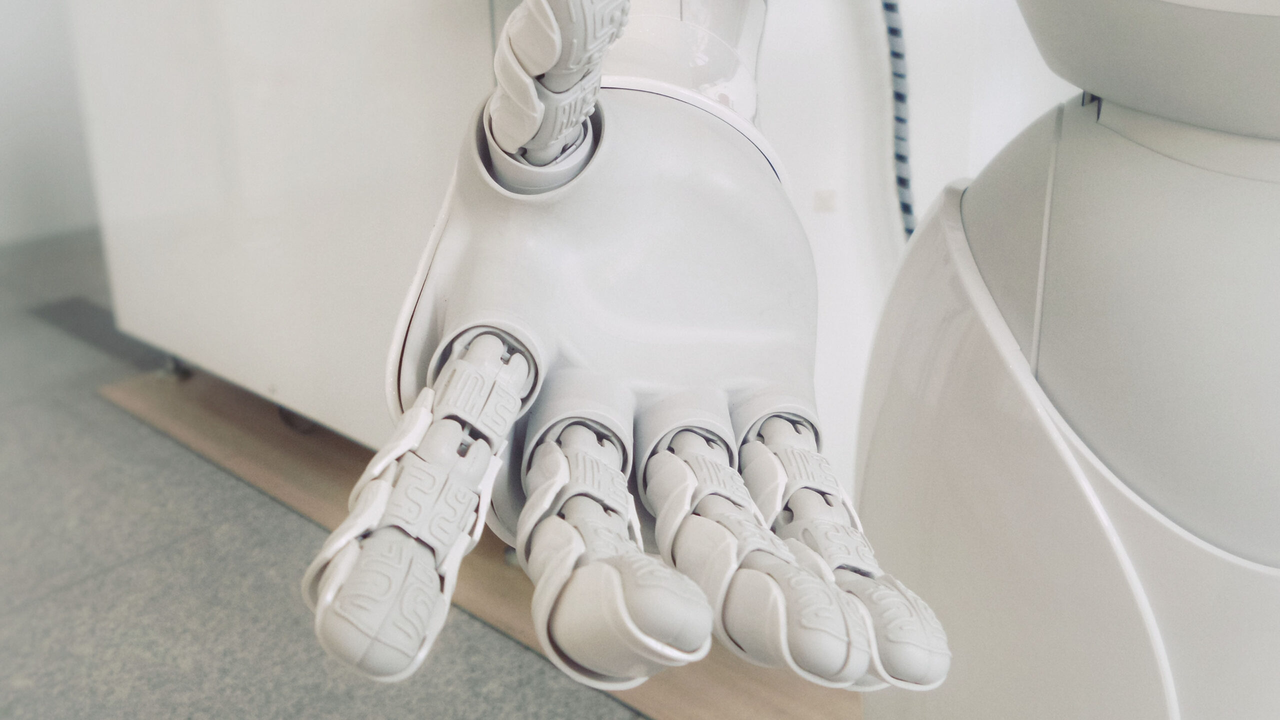 White robot hand.
