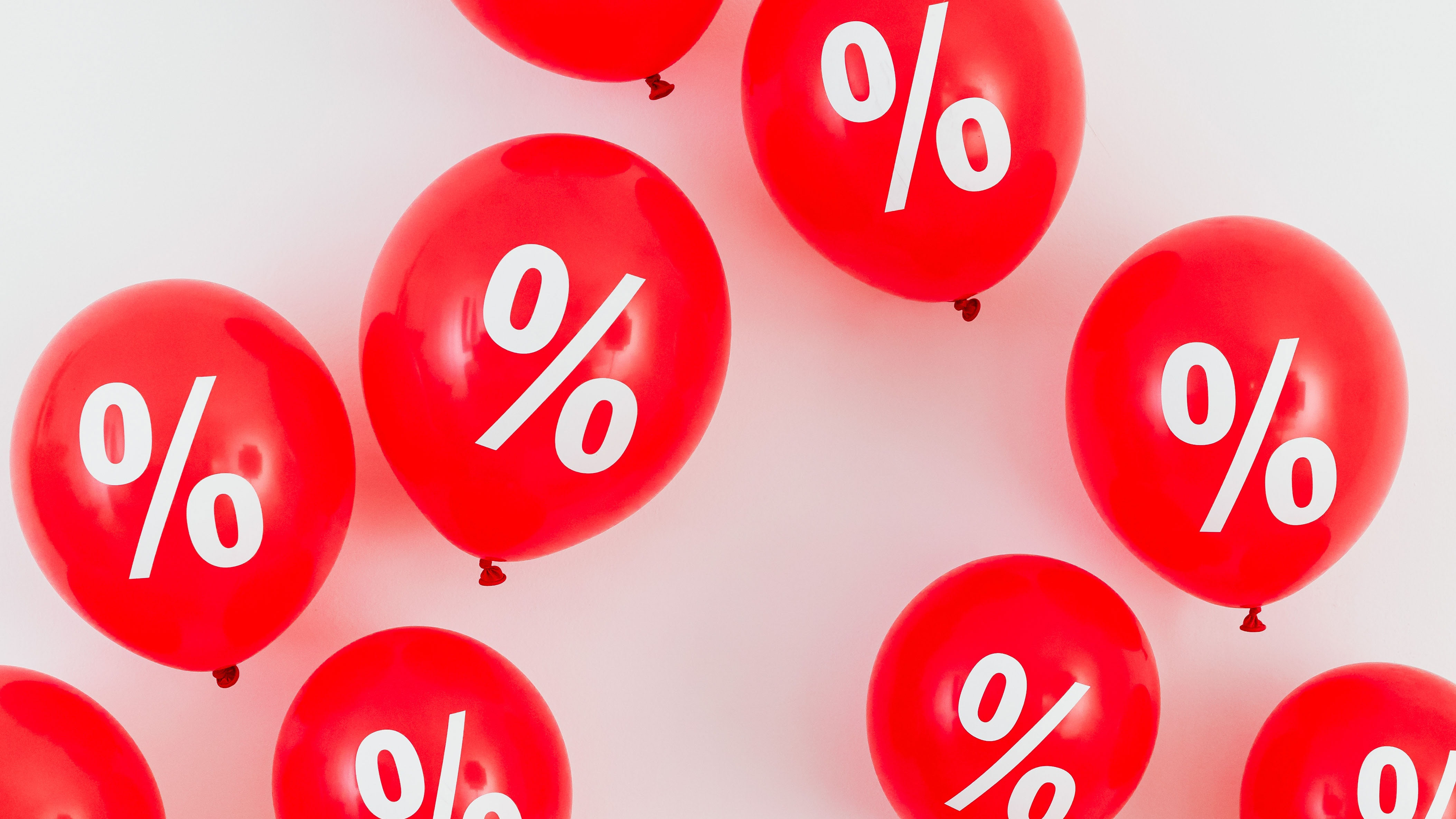 Reb balloons with percentage signs.