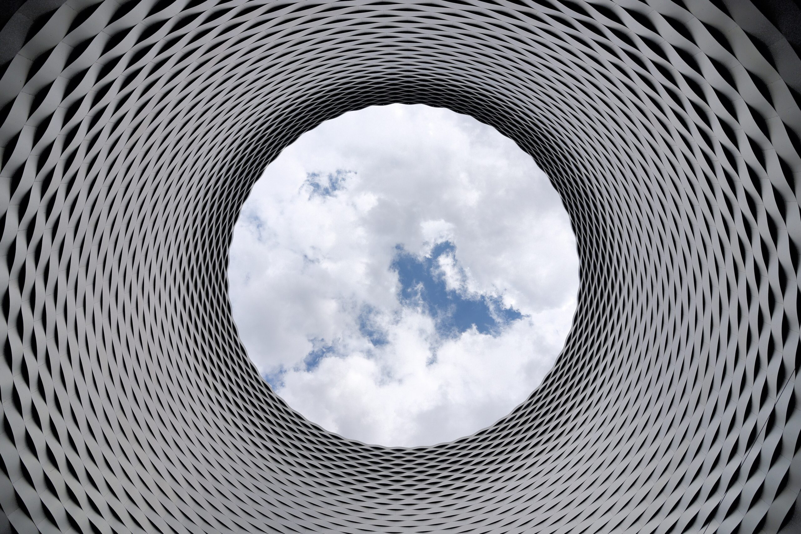 Interesting architecture with round shape, highlight opening toward sky.